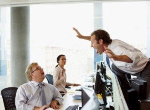 Businessman scaring co-worker in office
